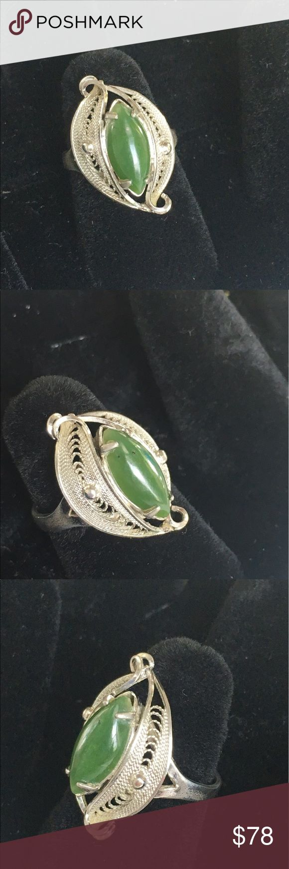 Vintage Sorento Sterling Jade ring spun silver A stunning and intricate vintage Jade and Sterling Silver ring. The Marquise cut Jade stone looks amazing next to the filigree type Silver work on the ring! This piece is marked Sorento Sterling. Approx size 5.5. Overall good vintage condition showing signs of age and use. Sorry NO TRADES! Vintage Jewelry Rings