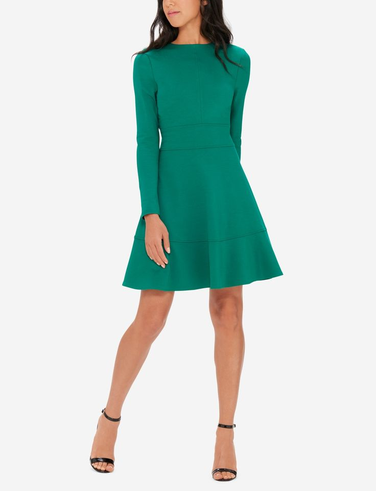 Exclusively from the Eva Longoria collection. This long sleeve dress has a lovely a-line silhouette for a confident fit you'll love. Power Ponte is an impeccable double knit fabric with amazing stretch. Think flawless fit from conference room to cocktails.