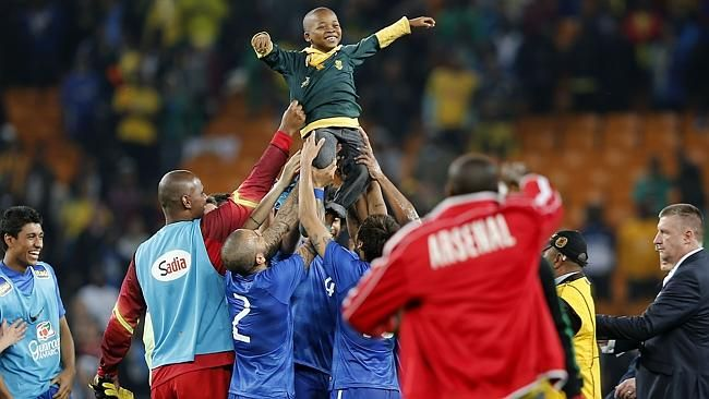 SA v Brazil Friendly | A South African boy who invaded the pitch is carried by Brazil's players. Source: AFP/ FoxSports
