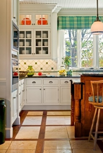 I like the floors and the cabinet design.  Overall on the cabinets but also that they go to the top of the tall ceiling. The glass keeps kinda modernizes it so it's not quite so much like old farm house cabinets.