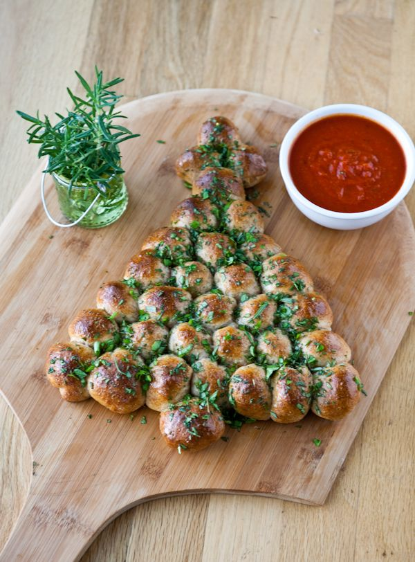Christmas Tree Pull Apart by EclecticRecipes.com I'd skip the ingredients and start with homemade bread dough, no cheese, but cover with garlic butter and parsley when it comes out of the oven.