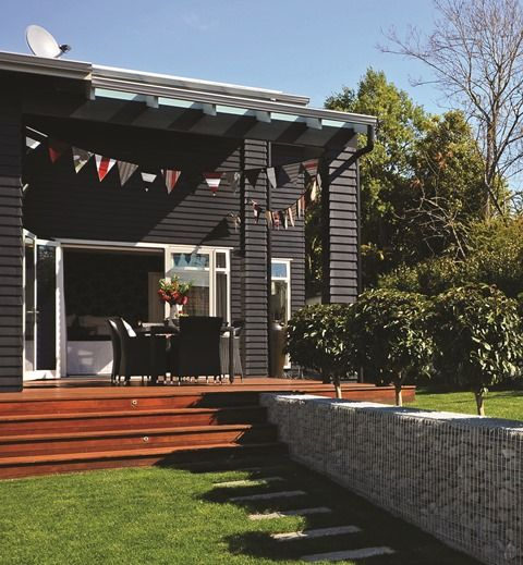 The home has been finished in striking black Linea weatherboard.