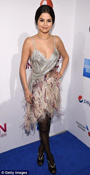 A tale of two outfits: Selena Gomez arrived in a flapper-inspired number but slipped into ...