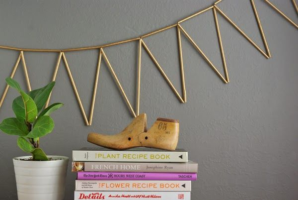 May have to try this DIY garland || String paper straws into triangle shapes and spray paint gold