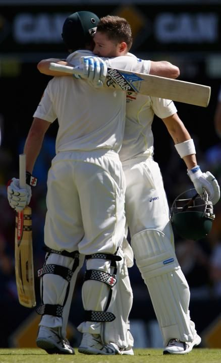 Australia's David Warner (R) celebrates his century next to England's Joe Root during the third day's play of the first Ashes cricket test match in Brisbane November 23, 2013. Australia's captain Michael Clarke (back) is congratulated by teammate George Bailey for his century during the third day's play of the first Ashes cricket test match against England in Brisbane November 23, 2013.