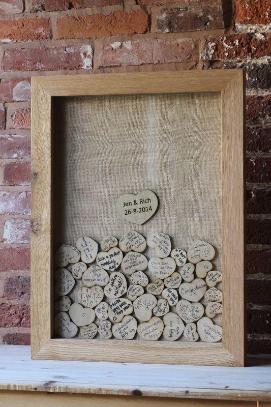 Casamento | Livro de Convidados (inspirações pra fazer o seu): Quadro de corações.  Um quadro de madeira com tampa de vidro ou acrílico. Em cima, uma fenda e vários coraçõeszinhos de MDF ou papelão. Seus convidados assinam e depositam no quadro, e você pendura na sua casa.