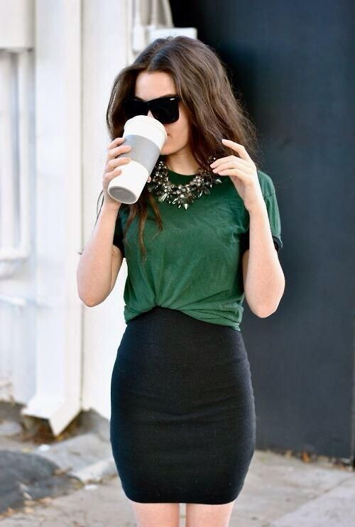 Slightly tucked t-shirt into high waisted mini skirt. Statement necklace and sunglasses as accessories.