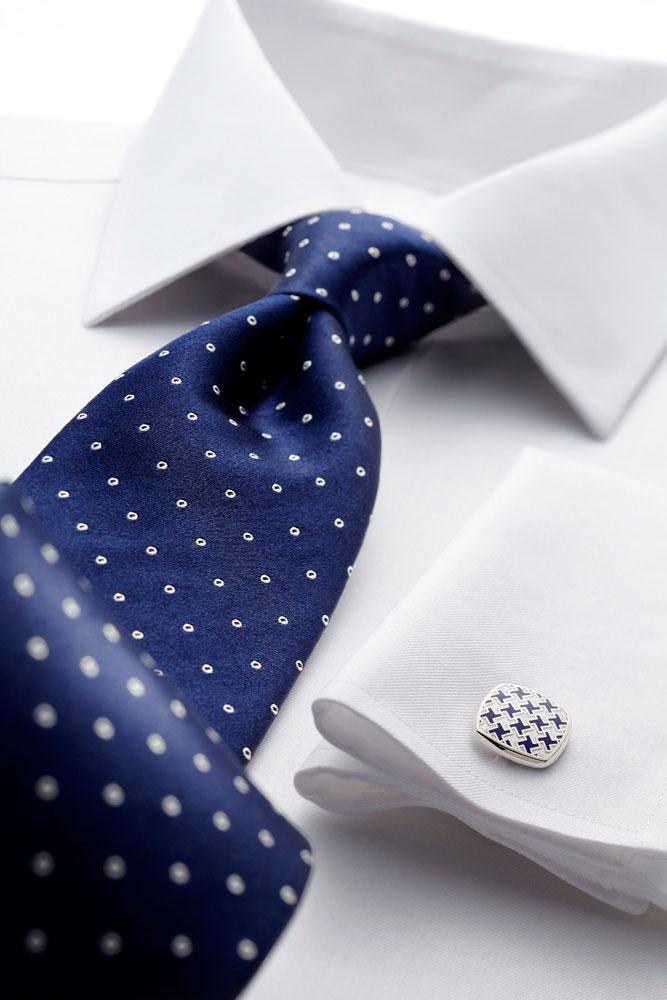 Navy and cream satin spot handmade tie.