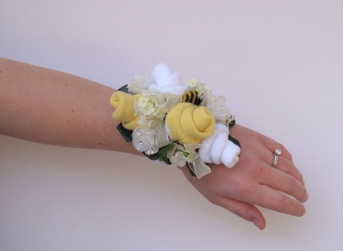 Baby Shower Sock Corsage Wristlets - rosettes made with baby socks