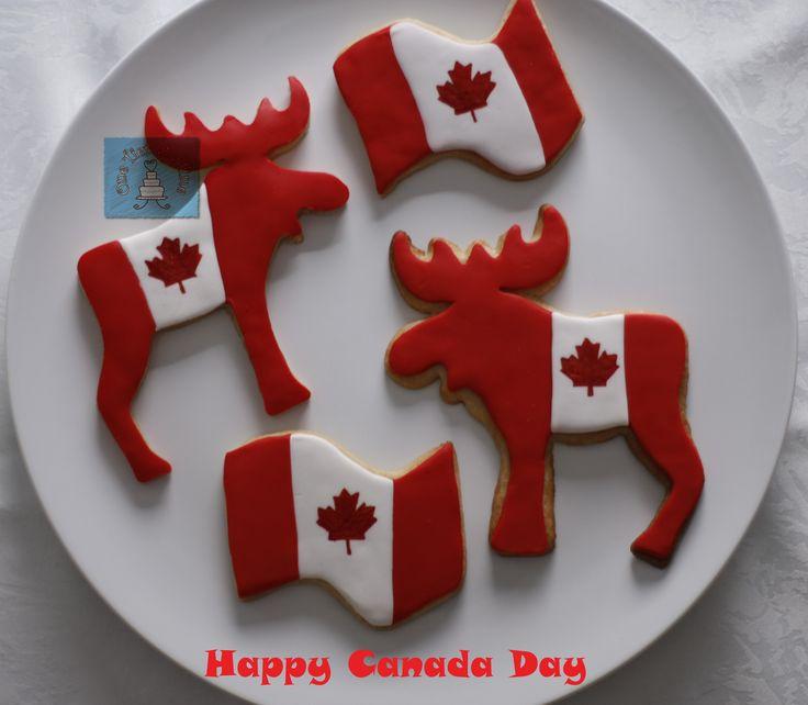 Happy Canada Day cookies.  Flag cookies, moose cookies, red and white cookies.