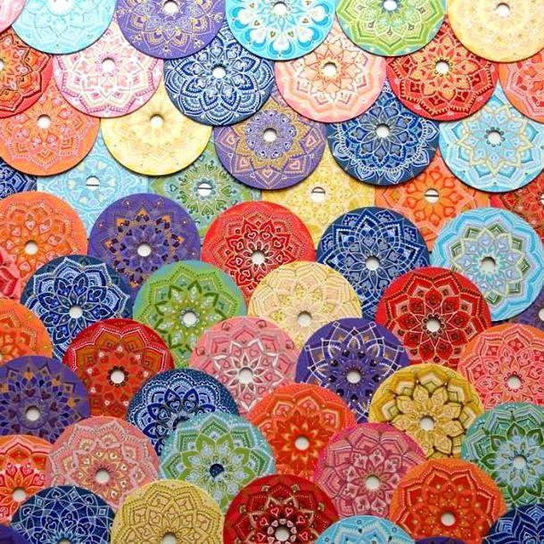 Mandalas painted on CD-s by Claudia Guerra