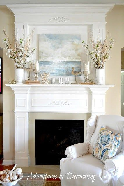 Beach painting with light florals and candles makes the perfect summer mantel decor display.  Click to see more! | Saving by Design