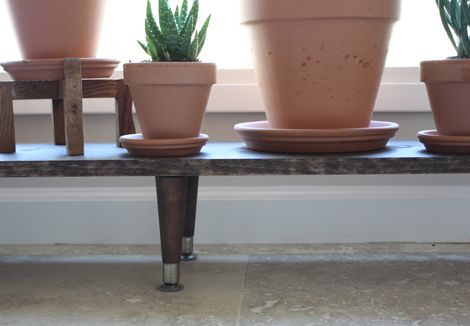 DIY plant stand -- furniture legs and wooden plank from Lowes then stained