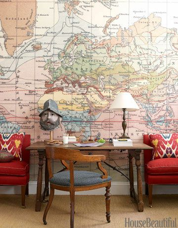 Designer Daniel Sachs gave a classic Park Avenue apartment an antique and global appeal, even in the young boy's bedroom. The wallpaper behind the desk is a blown up version of an antique world map.