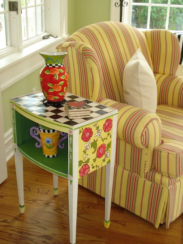 bright colored furniture. there is something about the bright colors and stripes of this vignette that i love love me some mary engelbreit type painted furniture colored