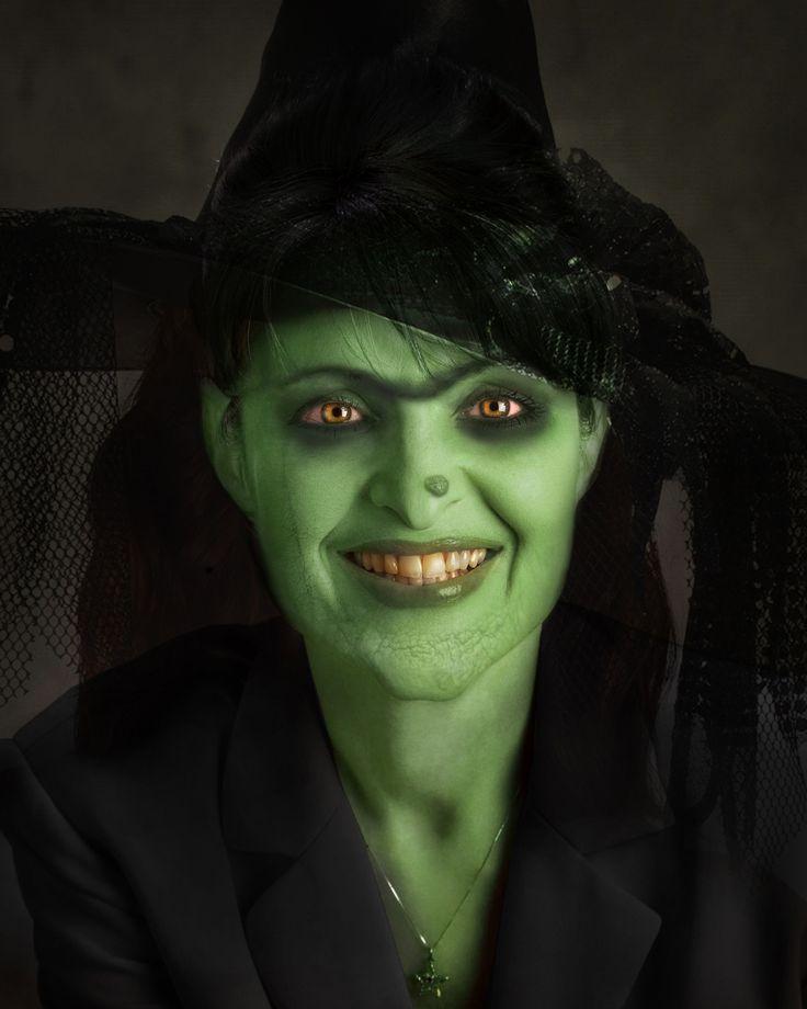 Classic wicked witch.. green face and all! Great make-up ...