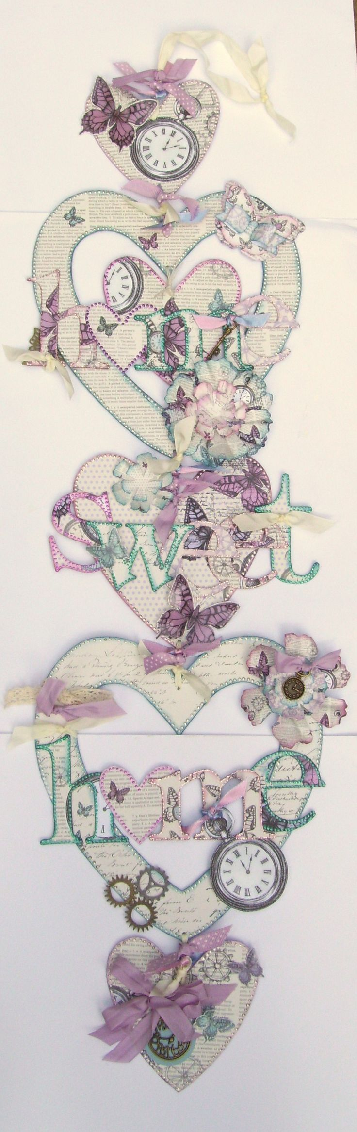 Home decor project using chipboard hearts, chipboard letters, ribbons and charms.  Wall hanging designed by Julie Hickey