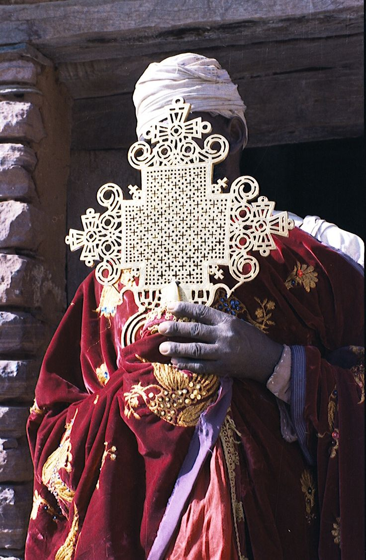 Priest with Ethiopian orthodox cross Holy Symbols