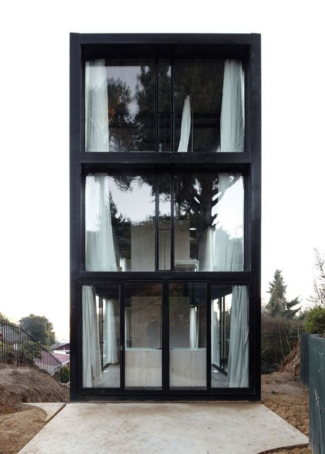 This earthquake-proof house on a hillside in western Chile by architects Pezo von Ellrichshausen has six rooms with glass walls