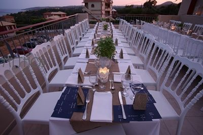 Wonderful table set up - wedding table decoration full of candles - white napoleon chairs #weddingsetup #weddingdecoration #whitenapoleon #weddngingreece #weddingreception