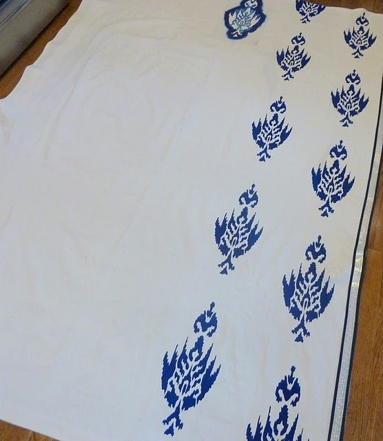 DIY ikat curtains. All you need is painter's drop cloths, paint and a stencil!