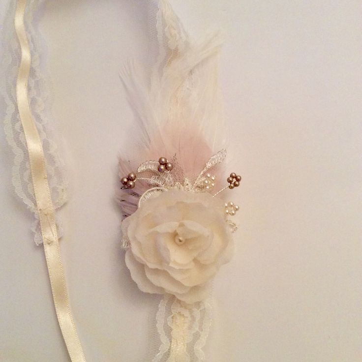 Bespoke hair ribbon tie with hand pressed silk flower and soft blush feathers.