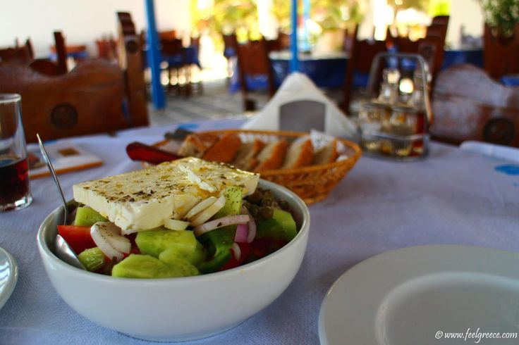 Horiatiki Salad, also known as Greek salad - tomatoes, cucumbers, green pepper, olives, onion and feta cheese...mmmmm  at Aliki Taverna, Kimolos, Cyclades Islands, Greece