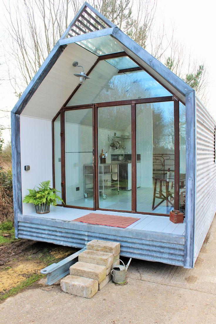Contemporary-shepherds-hut | A small shepherds hut with built-in front porch in Suffolk, England. Shared by Thomas Alabaster.