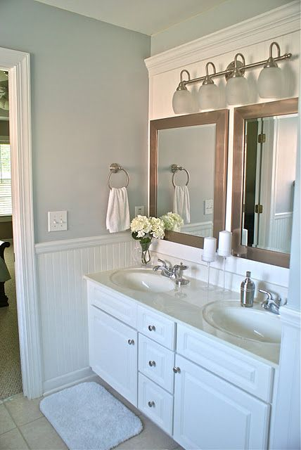 Amaing bathroom makeover! Love the idea to cover a large wall mirror!