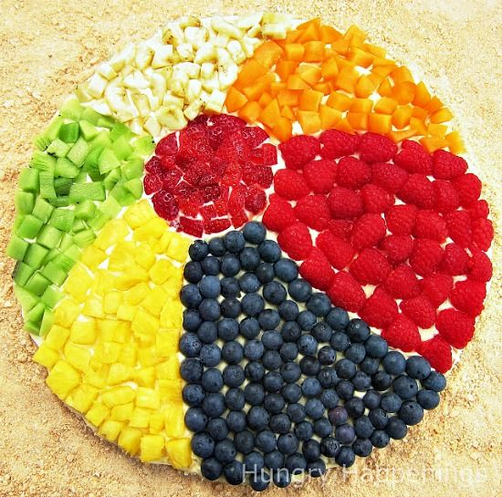 Edible Arrangement with Fruit in the Shape of a Beach Ball. Featured on BBL: http://beachblissliving.com/beach-party-food-ideas/