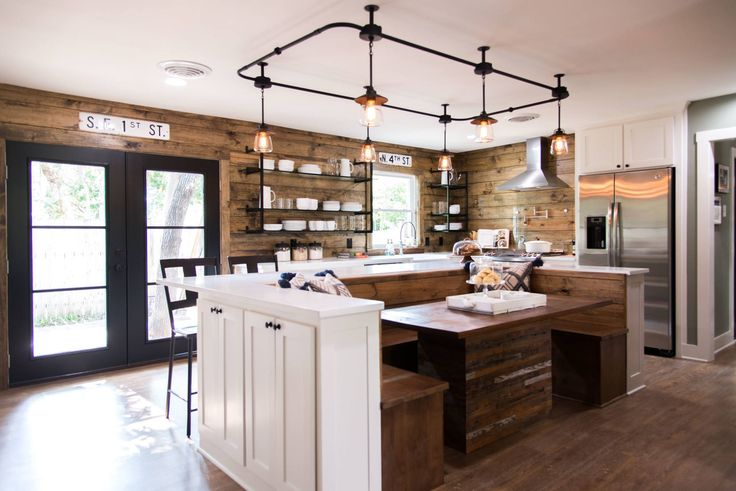 The custom built track lighting ties in modern-style lighting to this otherwise cabin-like kitchen.