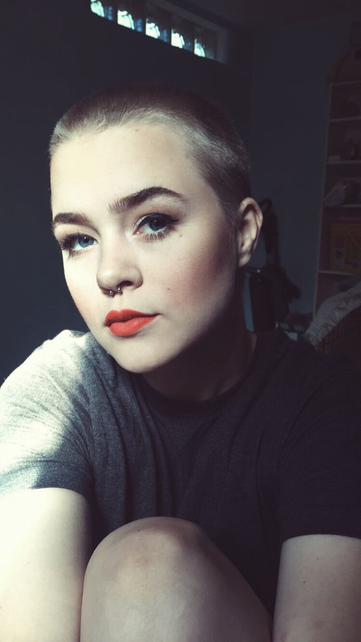 Buzzed women, shaved head