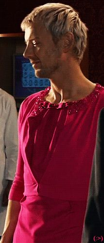 John Simm/The Master in pink ladies clothing. This just cracks me up because he looks so calm, as if he doesn't even notice what he's wearing. lol! John Simm is such a good sport :)