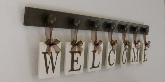 Hand painted hanging letters with wooden knob board and organza ribbon. Can also do child's name or family's last name.