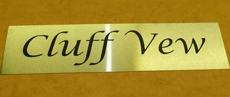 Stainless steel house sign custom engraved to your requirements
