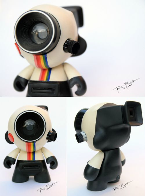 "Polaroid MUNNY - This brilliantly executed Polaroid Land Camera Munny was made by Patrick Bosworth who says, ""I had an old Polaroid OneStep Land Camera sitting around, so I figured I'd put it to good use."""