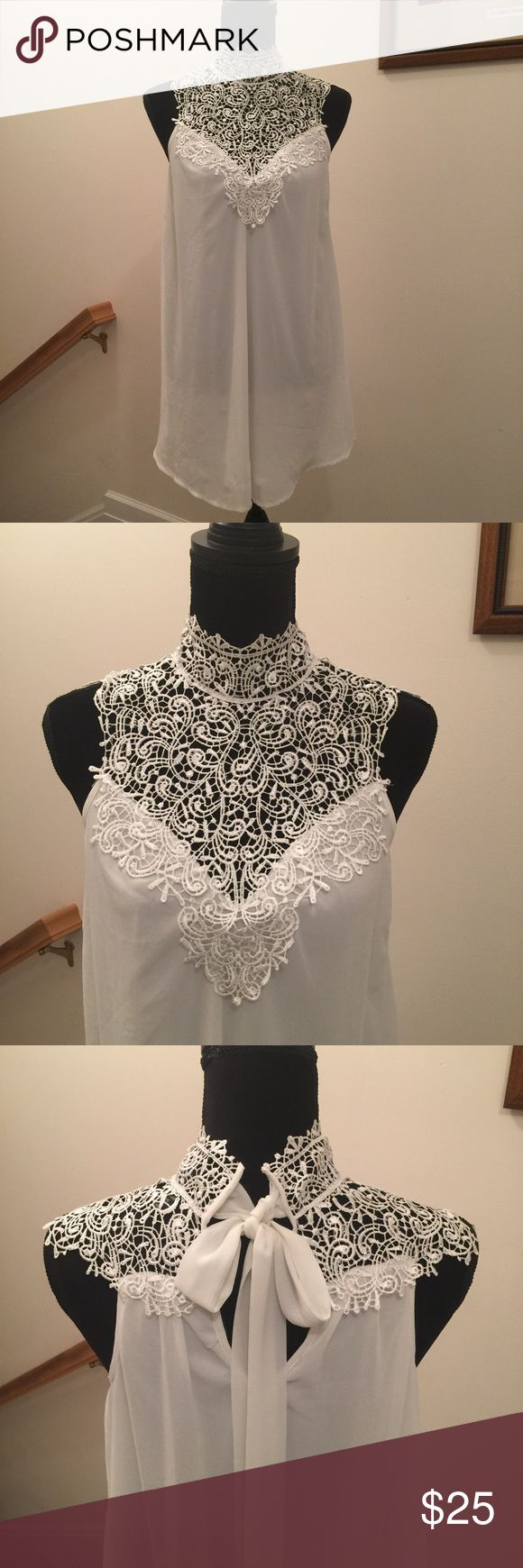 Beautiful ivory blouse The pyramid collection size large color Ivory and made out of 100% shell polyester Linning 100% polyester lace .100% polyester delicate lace at top. Hangs down to mid thigh. The pyramid collection Tops Blouses