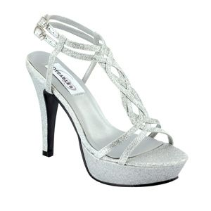 "Dyeables Vivi Shoe Silver Glitte r$61.99 Sparkle with a Twist. The Vivi is a glittery high heeled platform sandal with braided straps and double strapped clasps around the ankles. The choice for any formal occasion. The 3 5/8"" heeled Vivi is available in gold or silver glitter in medium width to size 11 and is not dyeable. http://www.bellissimabridalshoes.com/Dyeables-Vivi-Shoe-Silver-Glitter-Prodview.html"