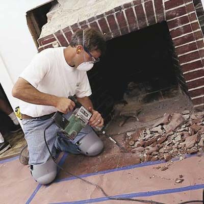 Sleek granite slabs can freshen up a tired, brick fireplace surround.  We show you how to install them.   Photo: Brian Wilder   thisoldhouse.com