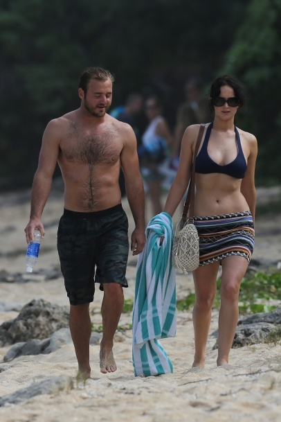 Jennifer Lawrence walks the beach in a black bikini top in Hawaii. 11-22-2012