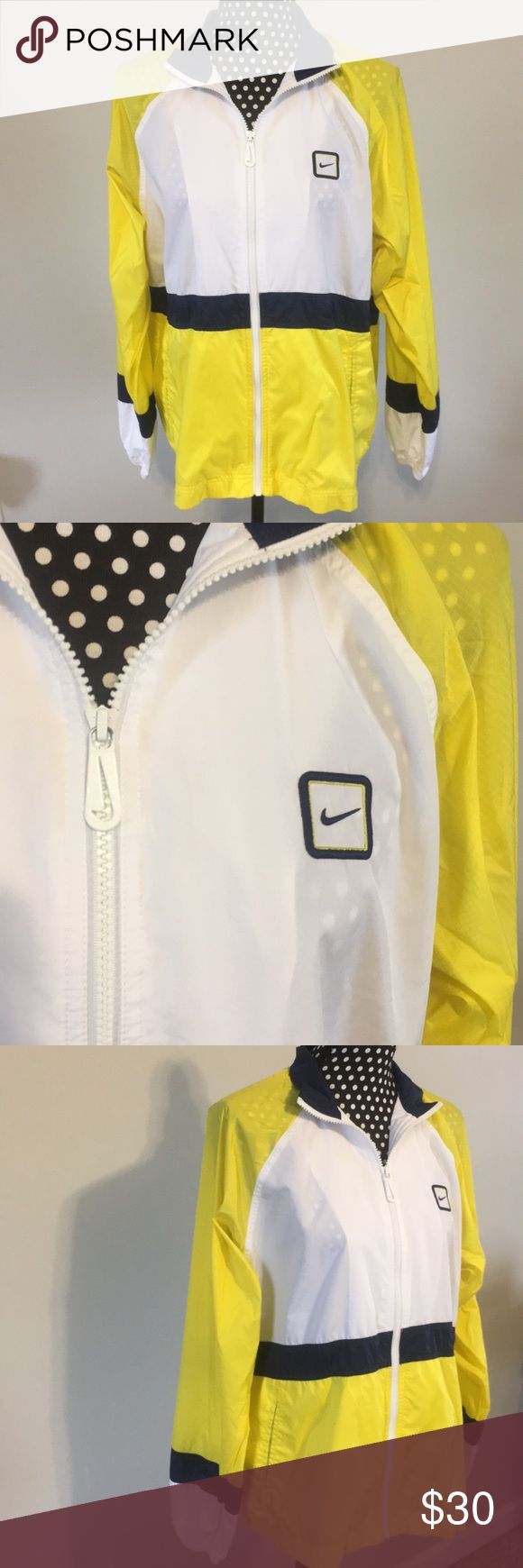 Nike windbreaker jacket Nike windbreaker is yellow, navy blue, and white. Perfect condition! Zips down the front. Size M(8-10). I think it could be a men's jacket or womens(: Nike Jackets & Coats