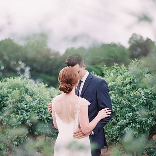 featured on @oncewed today!  my wedding with sweet @maggiecolletta at @morninggloryfarm.  Simple yet regal low chignon for russet hair, a dramatic back, & a beautiful green carolina backdrop   Hair & Makeup by #lulahairmakeup  Photo by @ryleehitchner  #northcarolinawedding #simplebride #outdoorbride #bridalbeauty #bridalhair #bridalmakeup