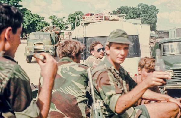 Late War Rhodesian Light Infantry. From these photos you can see the change in battle preparation. No longer shorts or T shirts and the use of chest rig, canvas and jacket webbing.