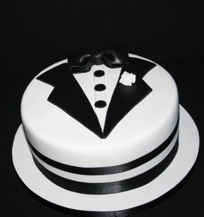 """A 10"""" chocolate biscuit cake with hand cut Tuxedo details to celebrate the union of George & Billy."""
