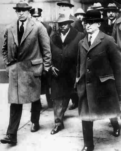 Marcus Garvey in custody of U.S. marshals en route to Atlanta federal prison, 1925