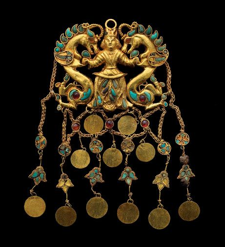 National Museum, Kabul. The pendant, dating from the first century A.D.  The ornament was part of the some one hundred gold objects taken from the graves of six Bactrian nomads.