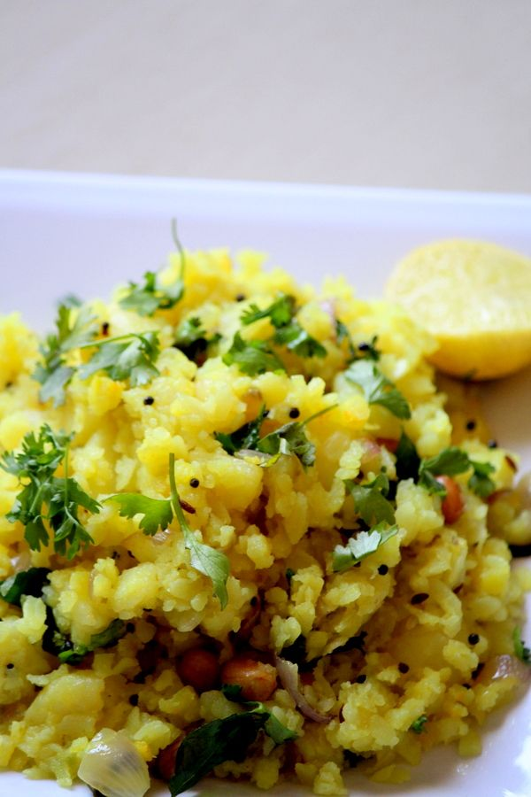 Aloo Poha recipe is a maharashtrian snack recipe and is a hugely popular snack dish made using flattened rice and potato and so is called as potato poha recipe. #snacks #breakfast
