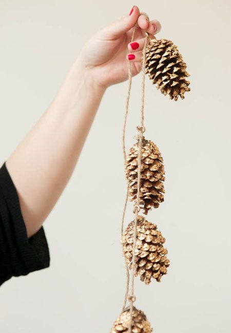 Insert tiny eye hooks into pine cones to create pine cone garlands.  Except the pine cones around my house are HUGE.