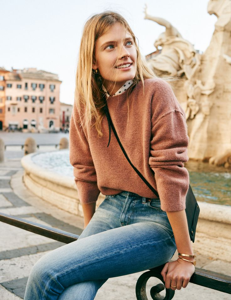 madewell connection sweater in sunset rose, silk courier shirt in foulard dot, the perfect fall jean, the morgan crossbody bag, arrowback double-sided earrings, gilded orb stacking ring + glider bangle bracelet worn by our muse constance jablonski in our fall catalog shot in rome. #everydaymadewell