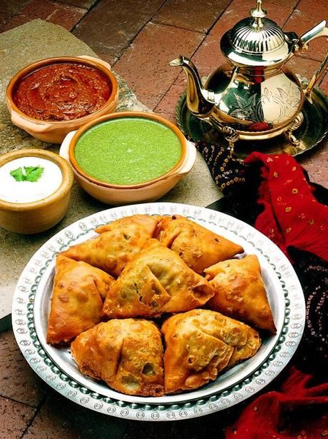 Traditional Indian Samosas - stuffed with a spicy potato and pea filling. Serve with hot black tea.
